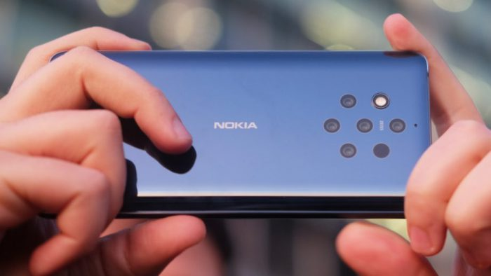 Nokia 9 PureView back in two hands 920x518