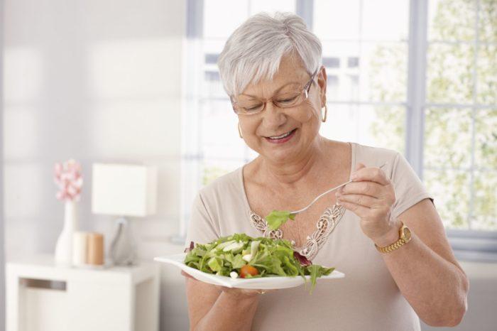 old woman eating salad swallowing nyul iStock 35971902 MEDIUM